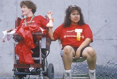 Volunteer coaching wheelchair athlete Stock Images