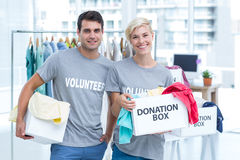 Volunteer couple holding donation boxes Stock Photography