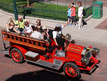 Volunteer fire department car. Paris,France,July 11th 2010: Upper view of an old-fashion Fire Department car transporting a group of tourists in the streets of royalty free stock photography