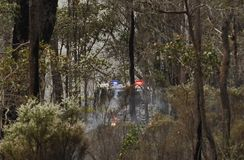 Volunteer Fire Fighters, Hemmed in by the Fire. royalty free stock photos