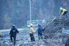 The Volunteer Firefighters helping to clean up after the forest fires stock images