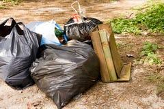 Volunteer Garbage litter in park or forest. Garbage litter in park or green forest Stock Photo
