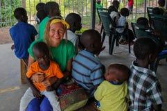 Volunteer girl in Africa with small children