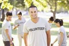Volunteer Group Clearing Litter In Park Royalty Free Stock Photography