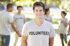 Volunteer Group Clearing Litter In Park Royalty Free Stock Image