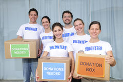 Volunteer group with food donation. Diverse volunteer group with food donation boxes Royalty Free Stock Photos