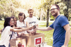 Volunteer group receives food donation Royalty Free Stock Images