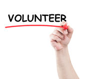 Volunteer. Hand writing volunteer underline text on transparent wipe board with white background and copy space stock photos