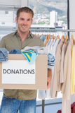 Volunteer holding donation box Stock Photos