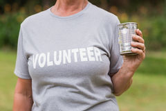 Volunteer holding tin can Royalty Free Stock Images