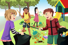 Volunteer kids. A vector illustration of kids volunteering by cleaning up the park Royalty Free Stock Photography