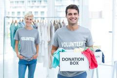 Volunteer man holding a donation box Stock Photo