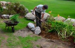 Free Volunteer Planting Flowers At Park Stock Photos - 43468343