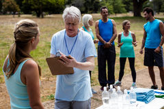 Volunteer registering athletes name for race Royalty Free Stock Photos