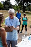 Volunteer registering athletes name for race Royalty Free Stock Photography
