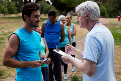Volunteer registering athletes name for race Stock Photos