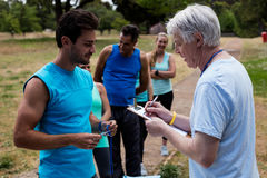 Volunteer registering athletes name for race Stock Photography