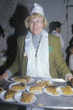 Volunteer serving pumpkin pie at homeless shelter for Christmas, Los Angeles, California Stock Photo