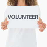 Volunteer showing a poster Royalty Free Stock Photos