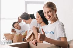 Volunteer showing thumb up Stock Photography