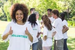 Volunteer showing thumbs up Stock Photos