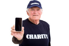 Volunteer smart phone Royalty Free Stock Image