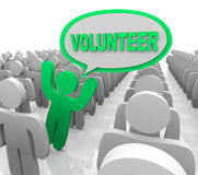 Volunteer Speech Bubble Person in Helper Crowd. The word Volunteer in a speech bubble spoken by a person who is promoting volunteerism to help others in need Royalty Free Stock Photography