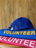 Volunteer uniform is lying on a shelf stock photos