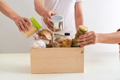 Free Volunteer With Box Of Food For Poor. Donation Concept. Stock Image - 116254821