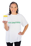 Volunteer woman showing jar Royalty Free Stock Photos