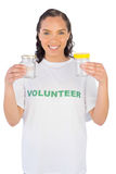 Volunteer woman showing two jars Royalty Free Stock Photo