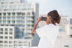 Volunteer woman using binoculars Royalty Free Stock Image