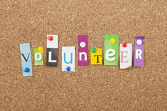 Volunteer Word. Charity and relief work concept stock image