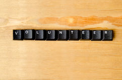 Volunteer word. With keyboard buttons stock photos