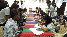 Volunteer work at community service. Young volunteers help register patients in a community health check up camp in India Royalty Free Stock Photography
