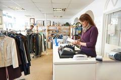 Volunteer Working In Charity Shop Stock Image