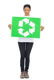 Volunteer young woman holding recycling sign Stock Photo