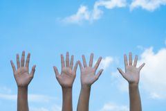 volunteering concept. Hands of people with blue sky on background stock image