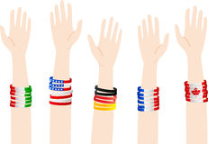 Volunteers. People of different nations raising their hands to become volunteers Stock Photo