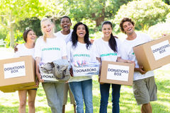 Volunteers carrying donation boxes in park Royalty Free Stock Photo