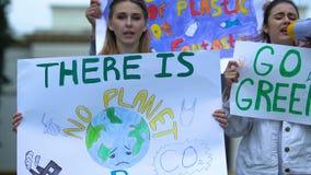 Volunteers chanting slogans go green, against deforestation, air pollution