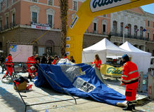 Volunteers of the Civil Protection dismantled a tent during the Deejay Ten Bari organized by Linus and Radio Deejay. Royalty Free Stock Photo