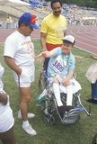 Volunteers coaching handicapped young athlete. Special Olympics, UCLA, CA Stock Photography