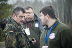 Volunteers decide how to move a damaged bridge on the way to Sievierodonetsk Royalty Free Stock Photo