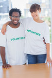 Volunteers embracing each other Royalty Free Stock Images