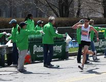 Volunteers encourage runners during the Boston Mar Stock Images