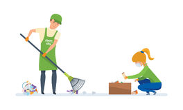 Volunteers engaged in cleaning of garbage, for further wasteless processing. Charitable affairs. Young volunteers are engaged in cleaning the territory of Stock Photos