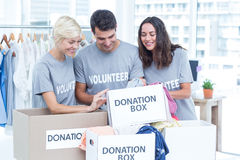 Volunteers friends checking a donation list Royalty Free Stock Photo
