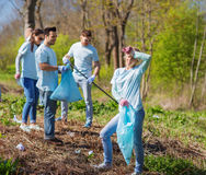 Volunteers with garbage bags cleaning park area Royalty Free Stock Image