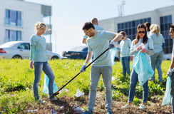 Volunteers with garbage bags cleaning park area Stock Photo